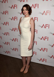 Anne Hathaway added a subtle pop of color with a pair of orange strappy sandals by Tamara Mellon.