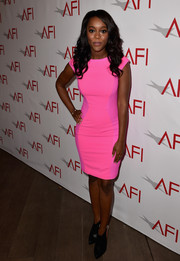 Aja Naomi King opted for a pair of black booties to team with her dress.