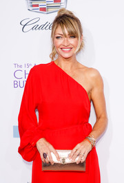 Rebecca Gayheart attended the Chrysalis Butterfly Ball sporting a gold envelope clutch and red one-shoulder dress combo.