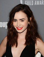 Lily Collins red lips simply popped against her fair skin tone and deep auburn hair.