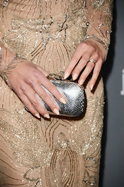 Cat Deeley added some extra shine to her already sparkly gown with a metallic silver clutch at the Costume Designers Guild Awards.