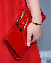 Ginnifer Goodwin paired her red dress with a red over sized snap clutch at the Costume Designers Guild Awards.