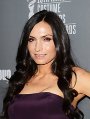 Famke Janssen's long black locks shined in the spotlight with loose curls and a center part.