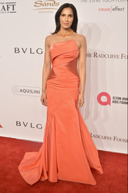 Padma Lakshmi wowed in a structured, strapless coral gown at the Enduring Vision Benefit.