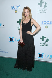 Mena Suvari went boho in a sleeveless black maxi dress at the Global Green pre-Oscars gala.