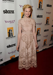 Elle Fanning looked regal in a floor-length lace evening dress at the Hollywood Film Awards.