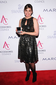 Deborah dazzled on the red carpet in this shimmery gunmetal dress.