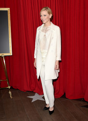 Cate Blanchett donned a white pantsuit with a matching coat at the AFI Awards.