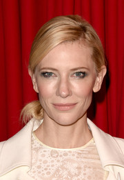 Cate Blanchett pulled back her golden locks with a side-parted bun.