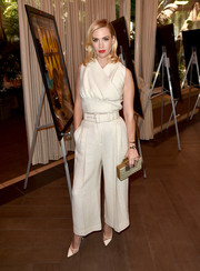 January Jones styled her look with a checkered box clutch by Rauwolf.