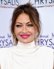 Rebecca Gayheart styled her hair into a sexy, loose ponytail for the Chrysalis Butterfly Ball.