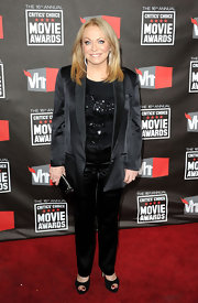 Jacki wears a black on black beaded blouse under her all black satin pant suit for the Critics Choice Movie Awards.