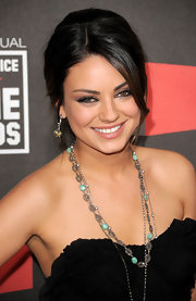 Mila Kunis added some sparkle to her look with a layered diamond necklace.