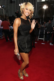 Keri wore a super mini LBD with out-there heels.