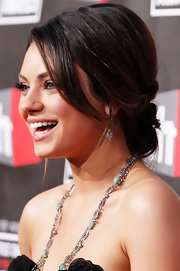 Mila Kunis proves that elegant hairstyles go a long way. The actress balanced her strapless dress with a timeless chignon.