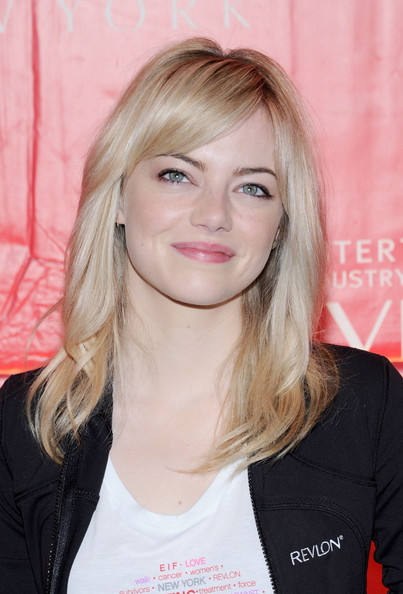 To complement her fair skin, Emma chose a blush pink lip color.