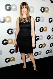 Judy Greer added a slight hint of color to her all black attire with a red snakeskin clutch.