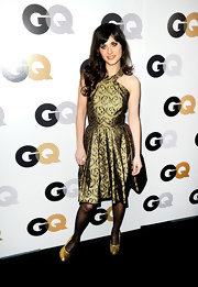 Zoeey Deschanel shined in a fit-and-flare cocktail dress at the GQ soiree in LA. The stylish starlet paired her look with glittering gold pumps.