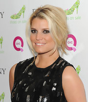 Jessica Simpson rocked a loose French twist while attending the FFANY shoe sale.