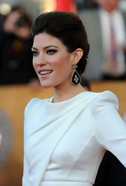 Jennifer Carpenter's black embellished earrings heightened the drama of her swept back hair.