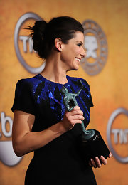 Sandra Bullock complemented her exquisite beaded frock with a pinned updo.