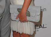 This light colored clutch with the jeweled detail is just what a white dress needed.