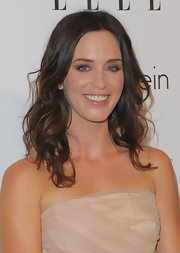 Emily rocks the now classic loose curls but is able to dress the hair style up with her elegant dress