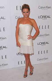 Becki worked the white carpet in metallic strappy sandals and a sweet strapless mini dress.