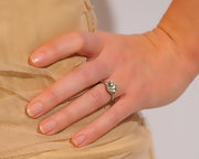 Emilys wedding ring sure does add sparkle to her dress.