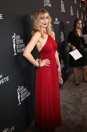 Meredith Monroe was red-hot at the Costume Designers Guild Awards in a side cleavage-baring halter gown.
