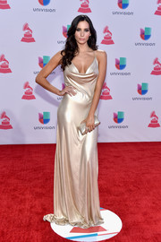 Genesis Rodriguez looked like a goddess in her champagne-hued cowl-neck gown at the Latin Grammy Awards.