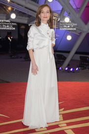 Isabelle Huppert looked impeccable in a white tie-neck gown by Lanvin at the Marrakech International Film Festival.