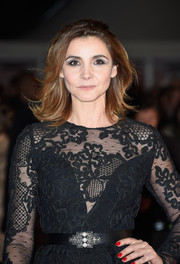 Clotilde Courau gave her black look a pop of color with her red mani.