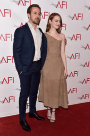 Emma Stone was all about relaxed glamour in this tan one-shoulder midi dress by The Row at the AFI Awards.