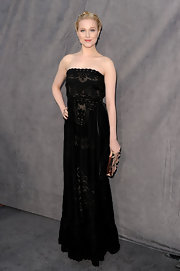 Evan Rachel Wood added subtle femininity to her black lace gown with a rosette-embellished clutch.