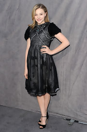 Chloe Moretz paired her black embellished cocktail dress with peep-toe sandals complete with scalloped detailing.
