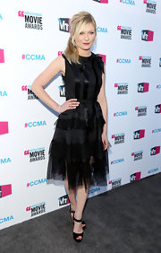 Kirsten Dunst added a girly factor to the little black dress with this bowed and tulle-adorned number.