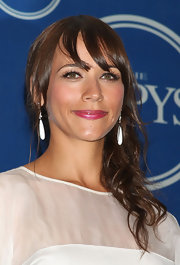 Rashida's white drop earrings strike a balance of classic yet on-trend.