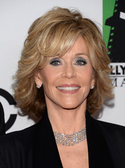 Jane Fonda wore her hair short with feathered waves when she attended the Hollywood Film Awards.