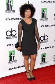 Angela Bassett hit the Hollywood Film Awards red carpet looking edgy-sexy in a Robert Rodriguez LBD with sheer sleeves.