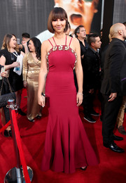 Jackie Cruz glammed it up at the Latin Grammy Awards in a red mermaid gown with a pearl-embellished neckline.