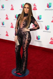 Jennifer Lopez was vampy as usual in a sheer, beaded jumpsuit by Zuhair Murad Couture at the Latin Grammy Awards.