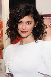 Audrey Tautou swept on a vivid orange-red lipstick for a screening of 'Delicacy.'