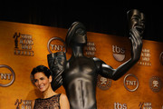 Actress Angie Harmon poses onstage during the 17th annual Screen Actors Guild Award nominations at the Pacific Design CenterSilverScreen Theater on December 16, 2010 in Los Angeles, California.