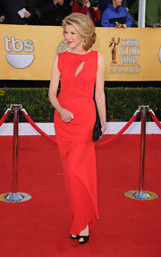 Christine Baranski paired her sultry red evening gown with black platform peep toes.