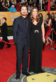 Sibi looked glamorous at the SAG Awards in a cowl neck black evening dress with an encrusted waist detail.