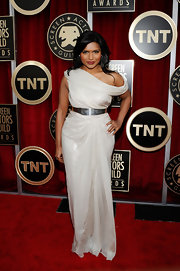 Mindy looked ravishing in an off-the shoulder cream evening gown.