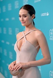 Emmy Rossum arrived for the Costume Designers Guild Awards carrying a beaded oval clutch by Christian Louboutin.