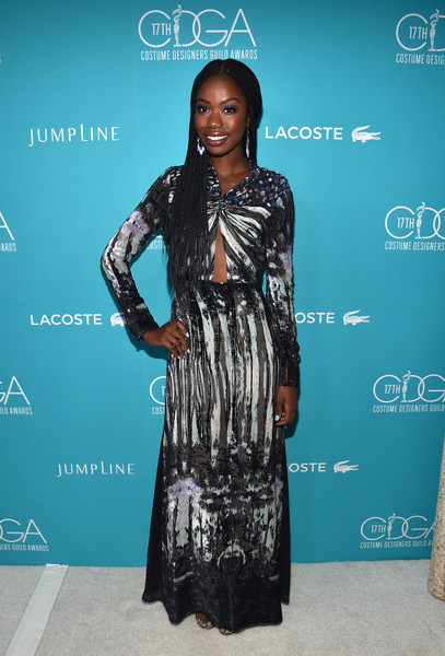 Xosha Roquemore looked subtly sexy at the Costume Designers Guild Awards in a long-sleeve BCBG Max Azria print gown with peekaboo detailing on the bodice.