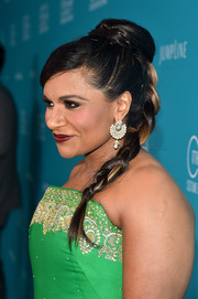 For the Costume Designers Guild Awards, Mindy Kaling styled her hair into a high bun that cascaded into a long braid.